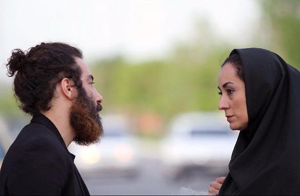 مریم پالیزان و نوید محمد زاده در نمایی از فیلم سینمایی